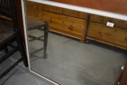 A vintage painted frame over mantel mirror