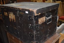 A vintage wooden travel trunk, including vintage shipping labels relating to Blue Star Line and Gold