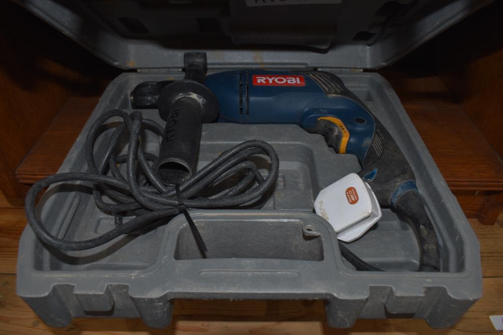 A corded Ryobi hammer drill