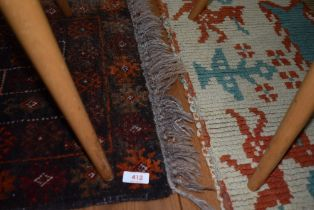 Two traditional prayer or similar rugs