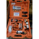A Paslode site work nail gun with batteries etc