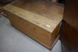 A stripped pine bedding box