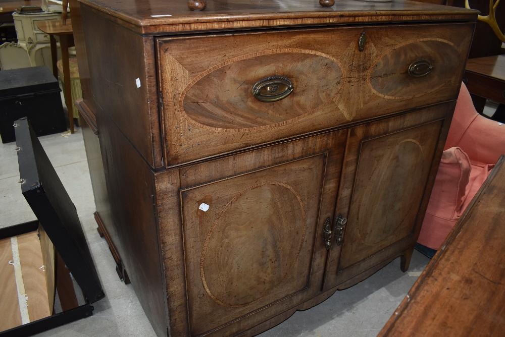 A 19th Century mahogany and inlaid secretaire having Regency style handles