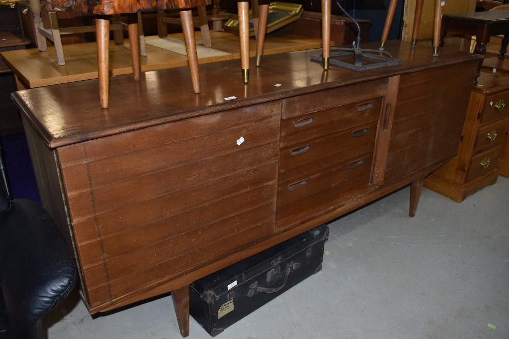 A vintage teak sideboard,could do with a tidy up