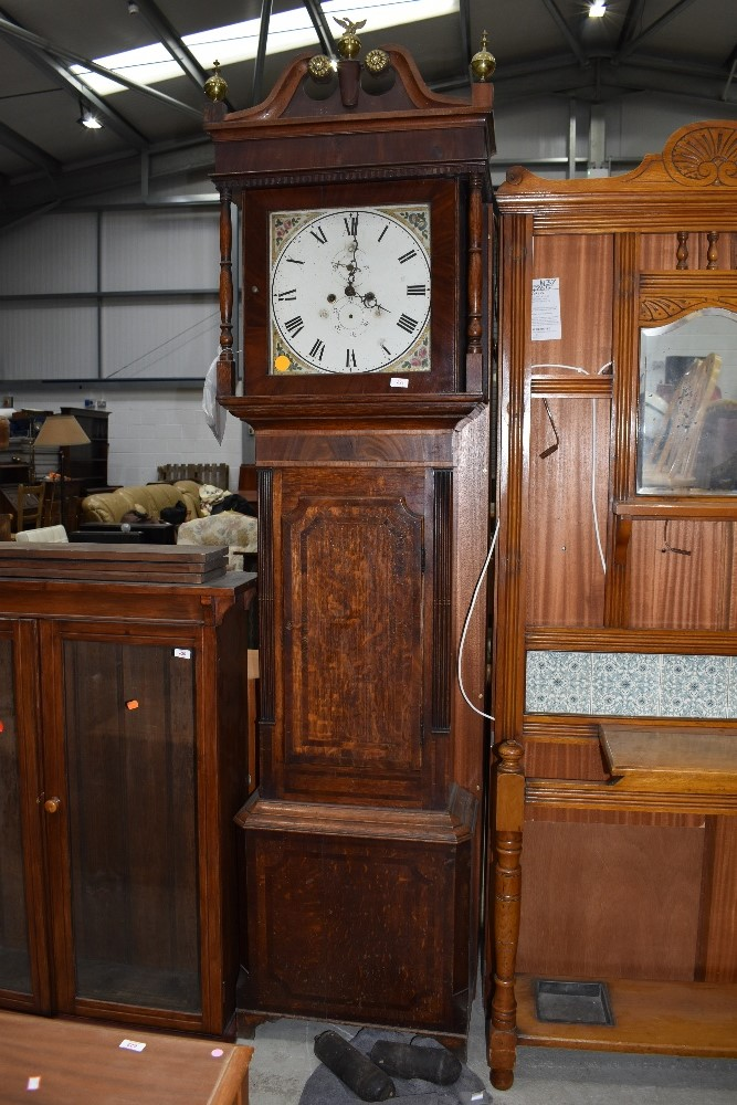 A 19th Century and later oak and mahogany long case clock having restored and painted dial, 8 day