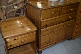 A modern pine bedroom chest of two over three drawers and a bedside unit