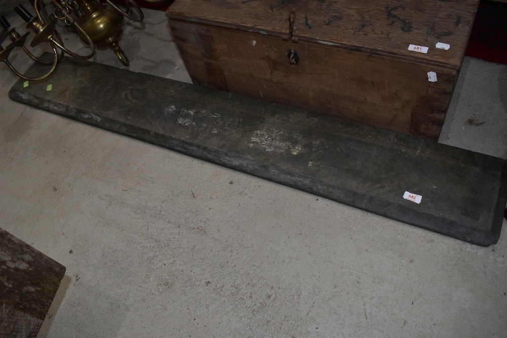 A slate mantel piece or lintel, width approx. 147cm