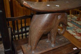A traditional tribal art carved elephant stool