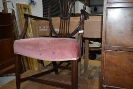 An antique mahogany framed carver chair