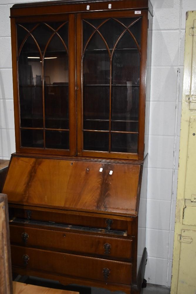 An early 20th Century mahogany and walnut bureau bookcase