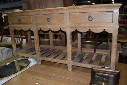 An American oak dresser base, possibly Ethan Allen, distressed finish