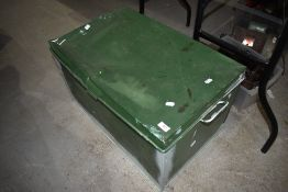 A vintage metal tin trunk or bedding box