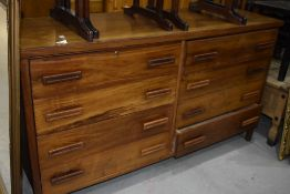 A teak sideboard/chest of eight drawer