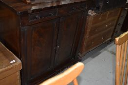 A Victorian mahogany shallow sideboard, two small drawers over double cupboard, on scroll feet
