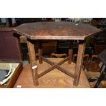 An Edwardian low octagonal table in oak