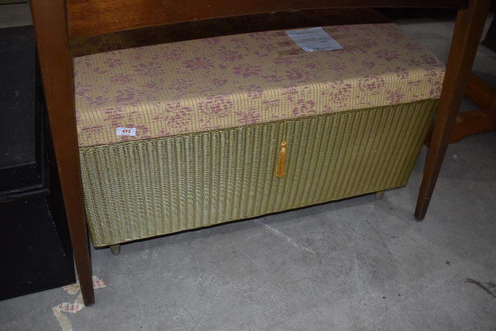 A Lloyd loom blanket box