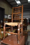 A traditional rush seated spindle back dining chair