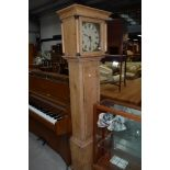 A lang case clock having stripped pine carcass with hand painted face and column hood