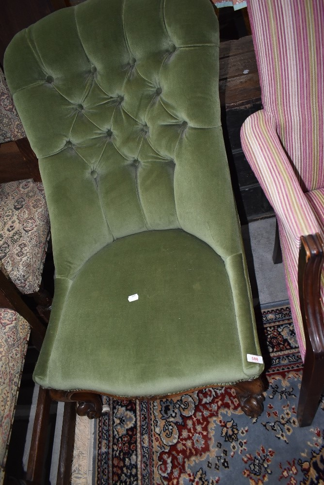 A traditional Victorian nursing chair having button back upholstery in green