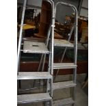 Two pairs of modern light weight metal step ladders