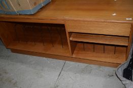 A vintage teak hifi sideboard having dividers for LP and singles, and cassette drawer