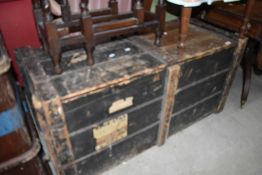 A vintage travel trunk or bedding box having distressed paint work with badges for blue star etc W50