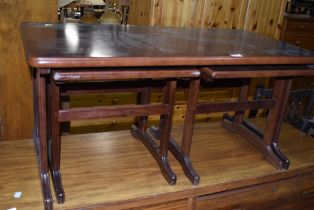 A mahogany effect coffee table nest