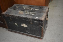 A vintage shipping trunk, worn labels