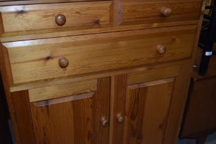 A modern pine cabinet, two over one drawer and lower cupboard section