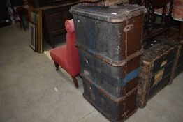 A vintage hard bodied travel trunk with wooden ribs