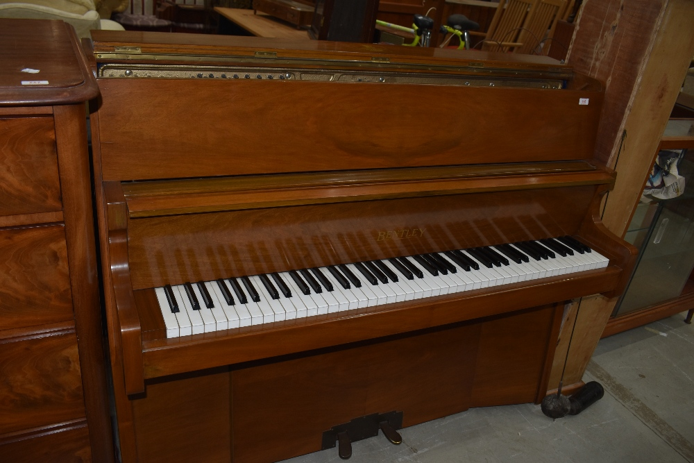 A six and a half octave up right piano in great condition by Bently Resonoura serial 103463