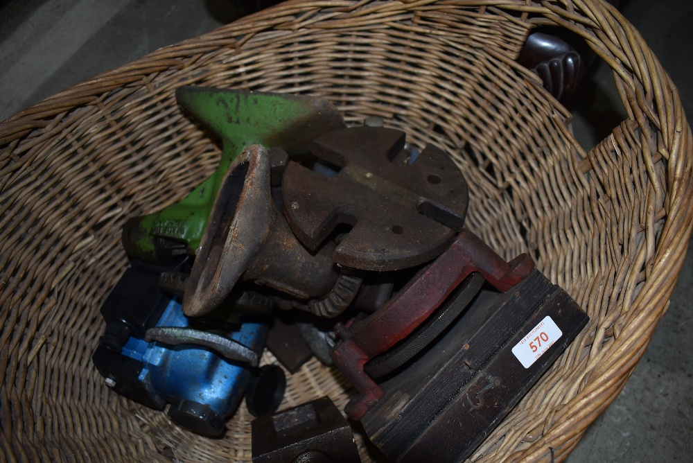 A selection of cast fitments and hardware including press and bottle jack