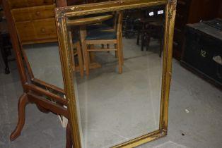 A reproduction gilt frame wall mirror