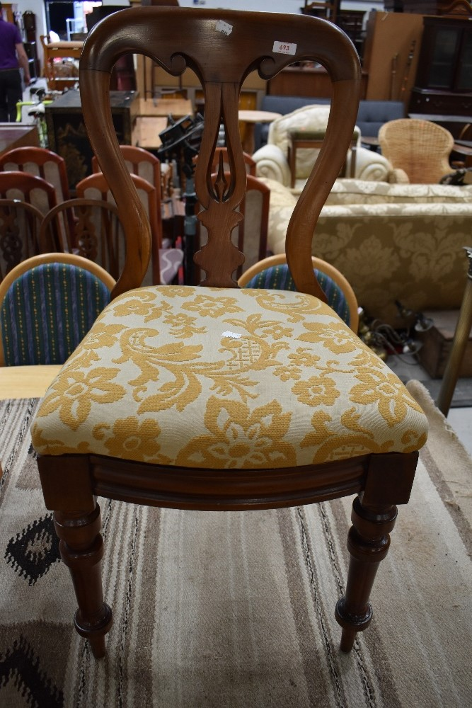 A Victorian mahogany dining chair , semi erotic design to back