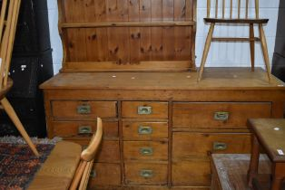 A pine shop counter or sideboard, four four and three drawers configuration with brass campaign