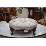 A small well carved mid 18th century foot stool