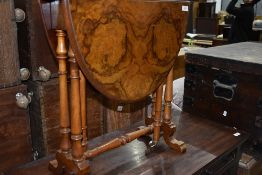 A 19th Century walnut Sutherland style occasional table, having turned frame, brass and pot casters
