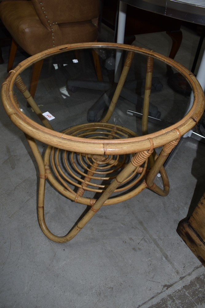 A bamboo framed low coffee table