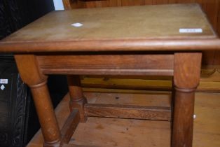A traditional oak coffin stool style occasional table