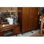 A vintage bedroom suite by E Gomme, G Plan, compsrising wardrobe, dressing table, double bed frame