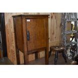 An early 20th Century oak pot cupboard