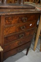 An early 20th Century mahogany and walnut chest of drawers, music style but with fixed drawer