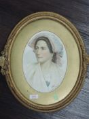 A watercolour, study of lady, oval, indistinctly signed, 26 x 20cm, plus frame and glazed