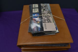 A collection of Royal Mail Presentation Packs in two albums and loose, 1970's to 1990's total face
