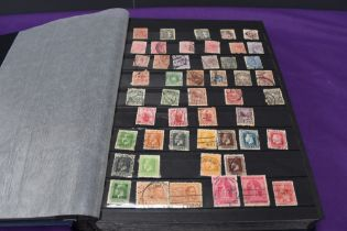 A large Stock Book containing New Zealand Stamps, early to modern, mint and used
