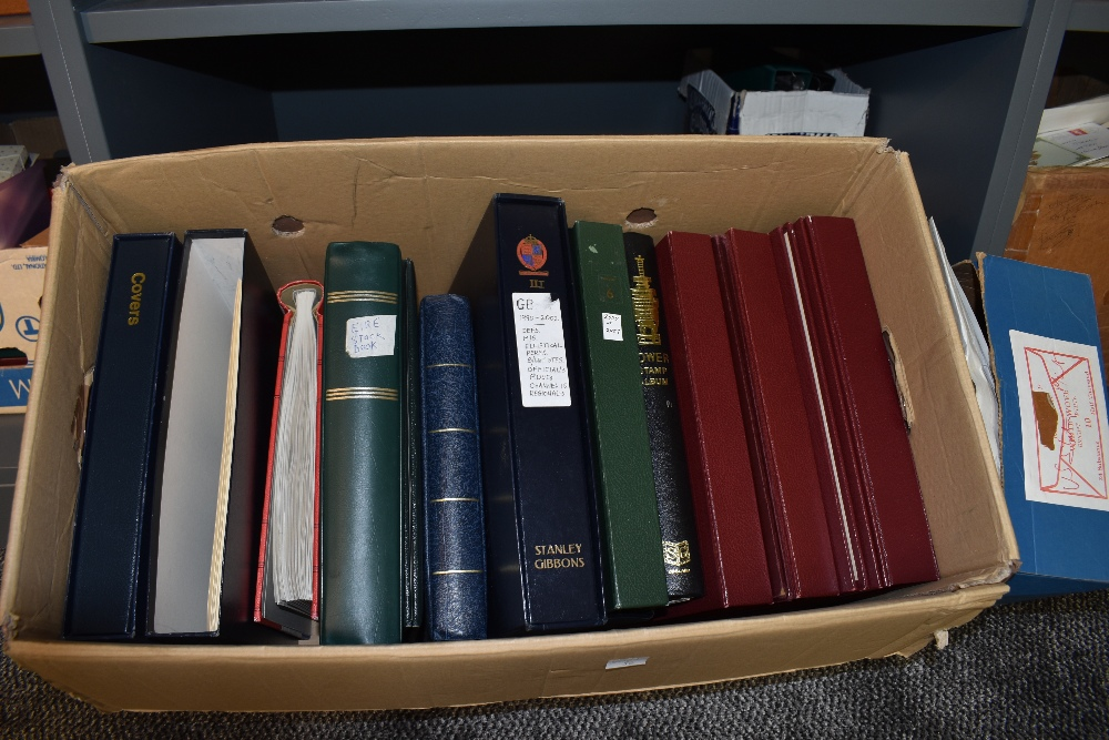 A box of Empty Stamp and Cover Albums