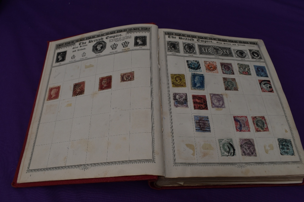 A vintage Empire Postage Stamp Album containing World Stamps including Commonwealth, mainly early