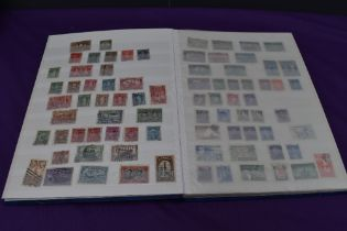A Stock Book containing Canada Stamps, early to modern, used