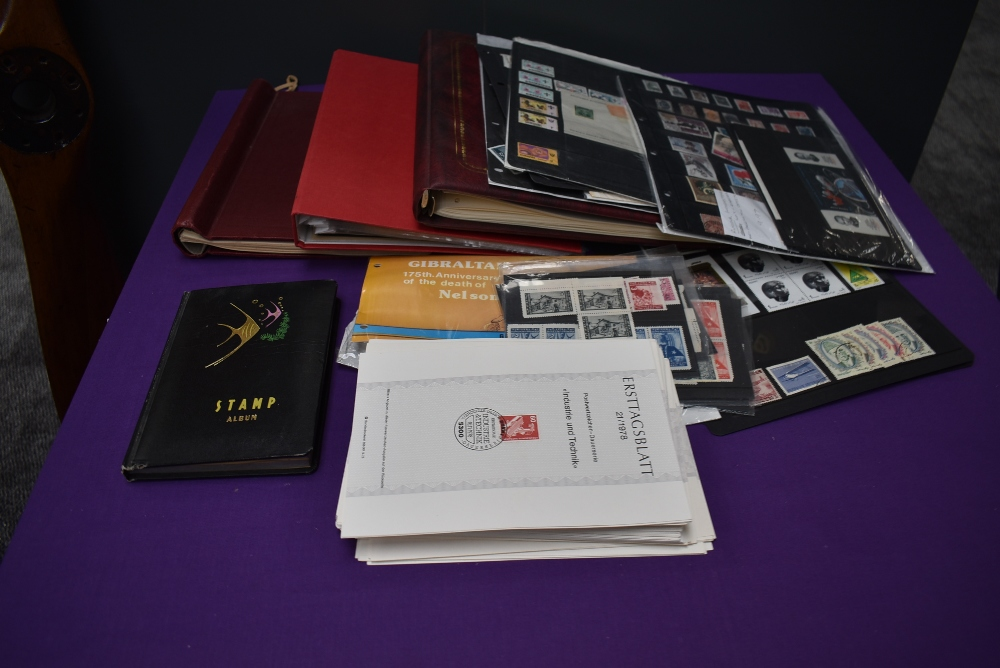 A box of World Stamps on Cards and in Albums, Mint & Used