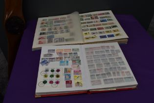 Two Stock Books of Commonwealth Stamps, George V to Queen Elizabeth II, most countries seen,